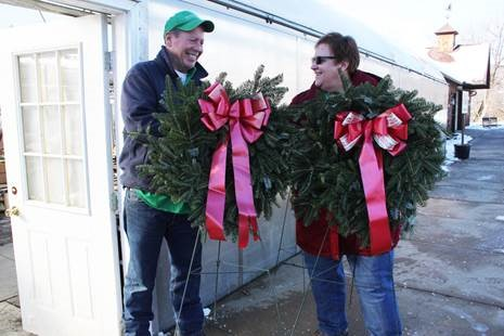 Dan Evans, owner of PleasantValley Greenhouses & Nursery, provides wreathes to Linda Manross for the graves of people we supported.